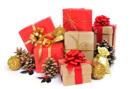 some christmas gifts wrapped with wrapping paper of different colors and ribbon bows, and some christmas ornaments on a white background photo