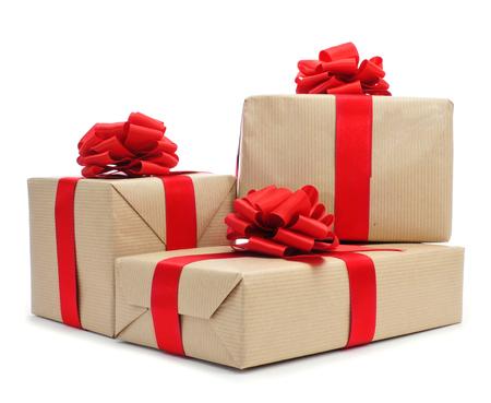 a pile of gifts with red ribbon bows on a white background  photo