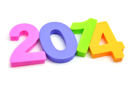 2014, as the new year, written with numbers of different colors on a white background photo