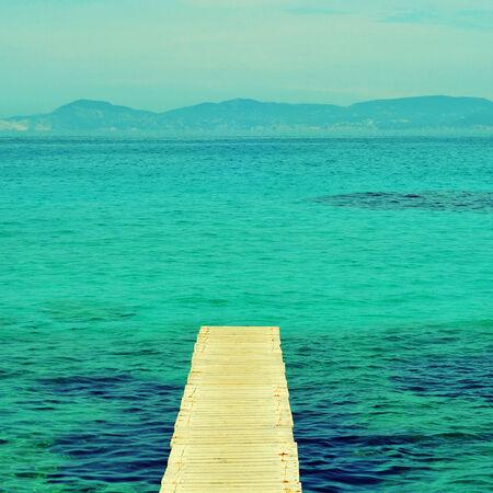 boardwalk in Ses Illetes Beach in Formentera, Balearic Islands photo