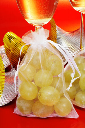 sachets: some glasses with spanish champagne and sachets with the twelve grapes of luck, traditional on the New Year in Spain