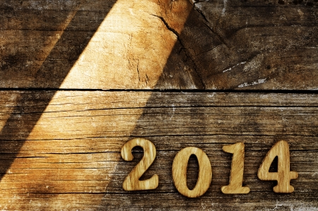 2014, as the new year, written with wooden numbers on an old wooden surface photo