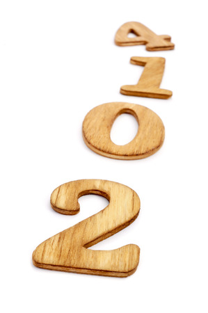 two thousand and fourteen: 2014, as the new year, written with wooden numbers on a white background Stock Photo