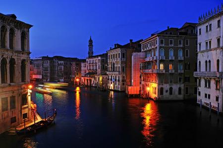 The Grand Canal from Rialto Bridge at night in Venice, Italy photo