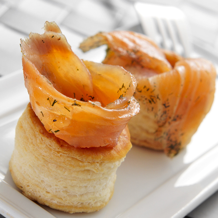 french cuisine: a plate with some volauvents filled with smoked salmon, served as appetizer Stock Photo