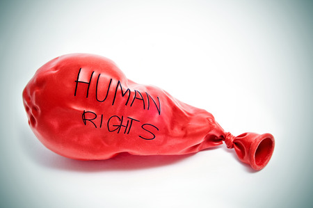 fair trial: text human rights written in a deflated balloon