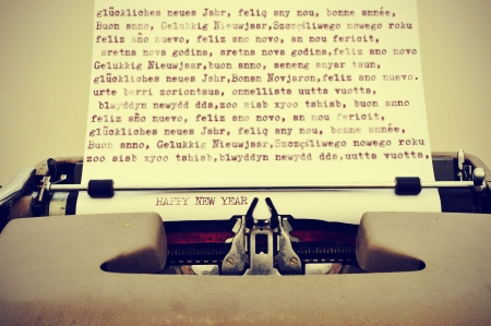 happy new year written in different languages with an old typewriter, with a retro effect photo
