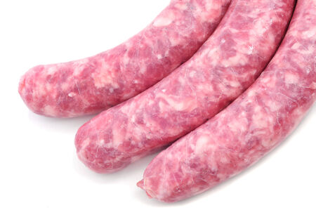 llonganissa: closeup of some uncooked pork meat sausages on a white background Stock Photo