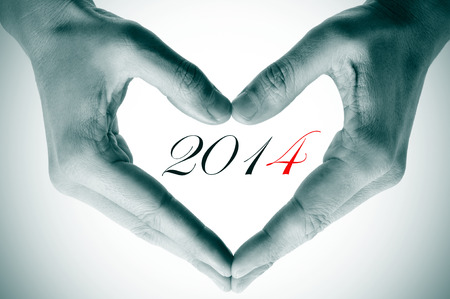 man hands forming a heart and the number 2014, as the new year photo
