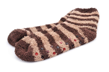 skid: a pair of striped non-skid socks on a white background