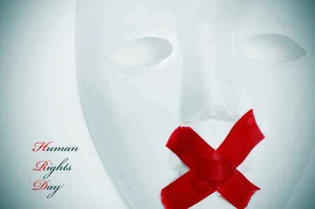 fair trial: a white mask with its mouth shut with red tape and the text human rights day