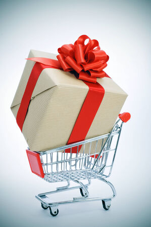 a huge gift with a red ribbon in a shopping cart photo