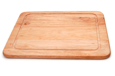 a wooden cutting board on a white background photo