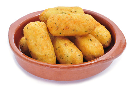 croquettes: an earthenware bowl with croquetas de bacalao, spanish codfish croquettes, on a white background