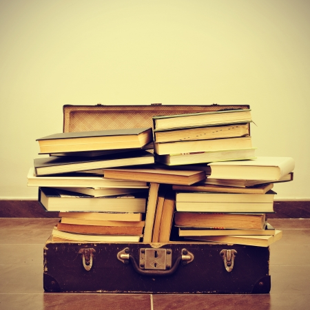 cramming: a pile of books in an old suitcase with a retro effect