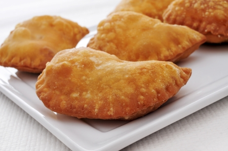 closeup of a plate with some spanish empanadillas, small meat or tuna pies, served as tapas photo