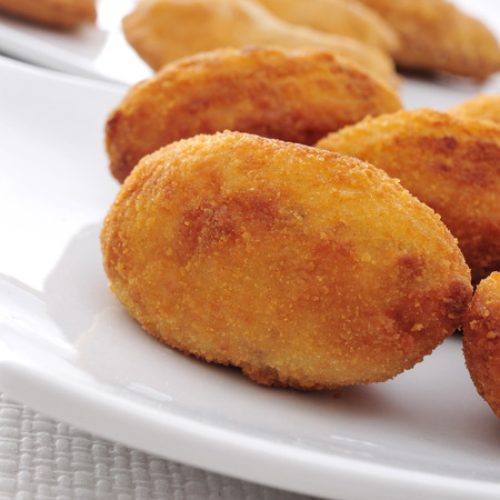 croquettes: closeup of a plate with croquetas, spanish croquettes, on a set table Stock Photo