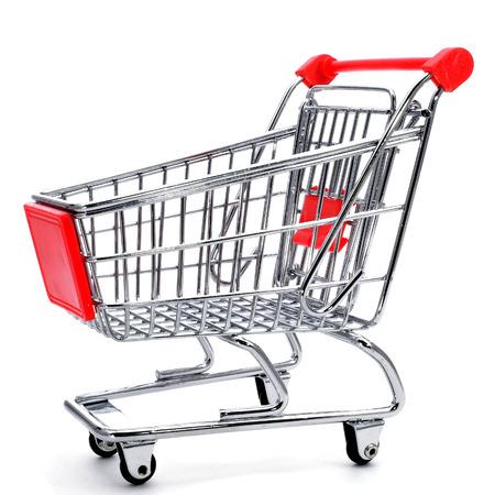 compras compulsivas: un carro de compras vacío sobre un fondo blanco