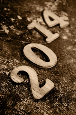 wooden numbers forming number 2014, as the new year, on an old and grunge surface photo