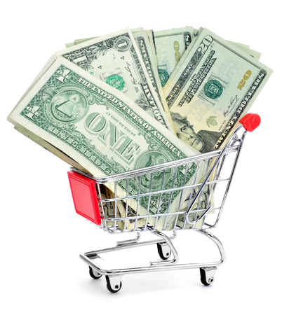 a pile of US dollar banknotes in a shopping cart photo