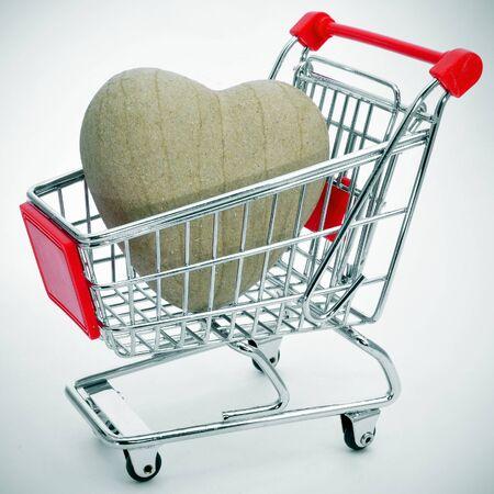 papiermache: a papier-mache heart in a shopping cart