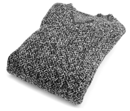 a folded sweater on a white background