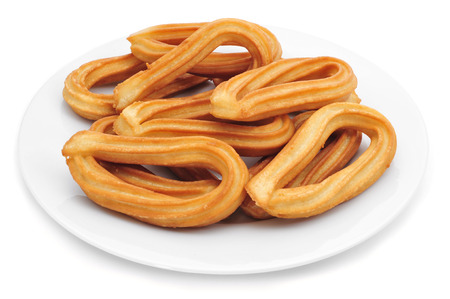 churros: a plate with churros typical of Spain on a white