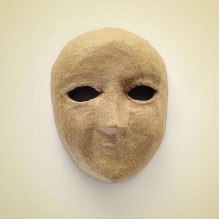 papiermache: picture of a papier-mache mask on a beige
