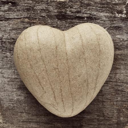papiermache: a papier-mache heart on an old wooden surface Stock Photo