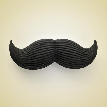 bigote: un bigote en un color beige que representa a un caballero, con un efecto retro