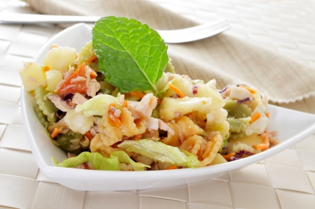 romaine: closeup of a bowl with refreshing pasta salad on a set table