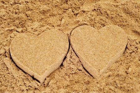molded: molded sand hearts on the sand of a beach