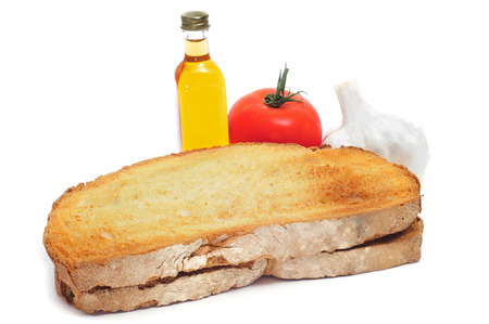 catalonia: toasted bread, tomato, garlics and olive oil to make pa amb tomaquet, bread with tomato, typical of Catalonia, Spain