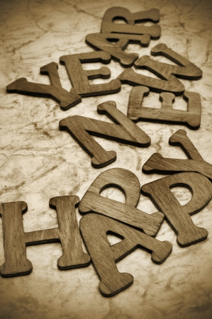 wooden letters forming the sentence happy new year on a marbled background photo