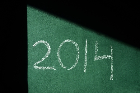 2014, as the new year, written with chalk on a green chalkboard photo