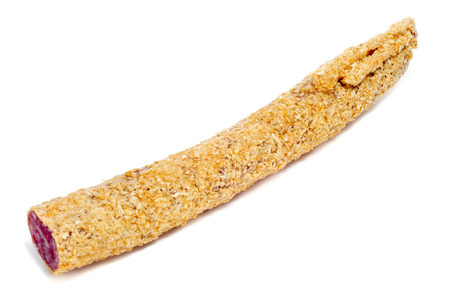 embutido: a fuet, a spanish sausage, coated with onion on a white background Stock Photo