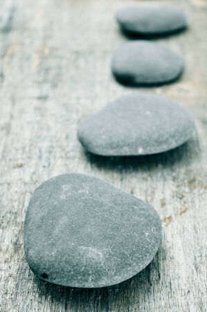 a pile of stones on an old wooden surface Stock Photo - 24633325