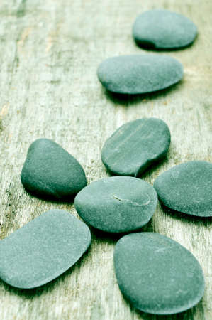 some stones forming a flower on an old wooden surface Stock Photo - 24716488