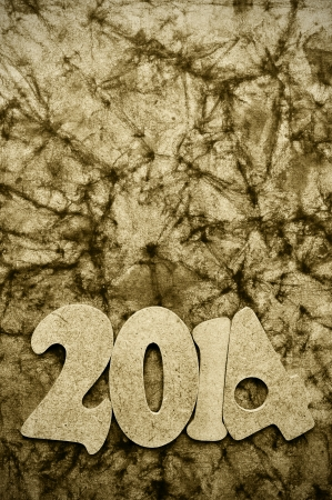 numbers forming 2014, as the new year, on a wrinkled background photo