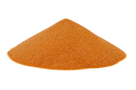 a mound of sand on a white background photo