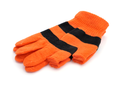 a pair of gloves with open fingertips for thumb and index fingers on a white background photo