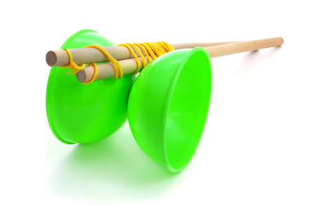 a green diabolo on a white background photo