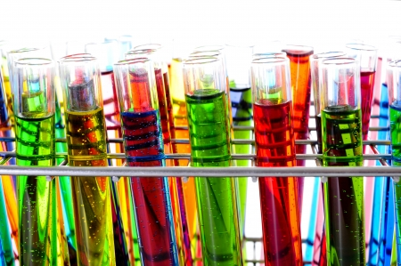 closeup of a pile of test tubes with liquids of different colors photo