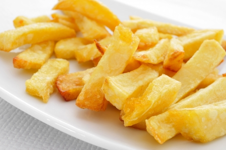 buffet table: a plate with appetizing french fries on a set table