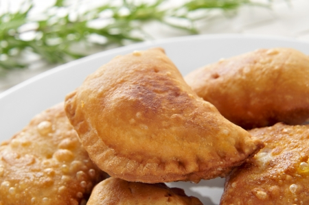 tapas: closeup of a plate with some spanish empanadillas, small meat or tuna pies, served as tapas