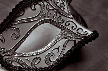closeup of an elegant carnival mask in black and white photo