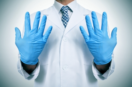 a doctor wearing blue medical gloves