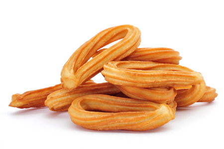 fritter: a pile of churros typical of Spain on a white background