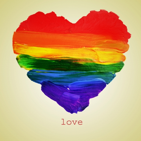 the word love and a rainbow heart painted on a beige background, with a retro effect