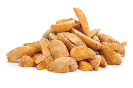 wedges: a pile of frozen home fries ready to fry on a white background
